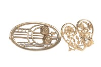 Lot 605 - FOURTEEN CARAT GOLD HEART BROOCH with thistle...