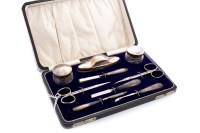 Lot 833-GEORGE V SILVER MOUNTED CUTICLE SET maker H. J....