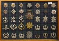 Lot 1666-CASE OF SCOTTISH REGIMENT CAP and other BADGES...