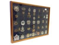 Lot 1667-CASE OF SCOTTISH REGIMENTAL CAP and other BADGES...