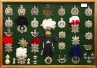 Lot 1669-CASE OF SCOTTISH REGIMANTAL CAP BADGES including...