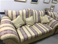 Lot 15-RED AND FLORAL UPHOLSTERED THREE SEATER SETTEE