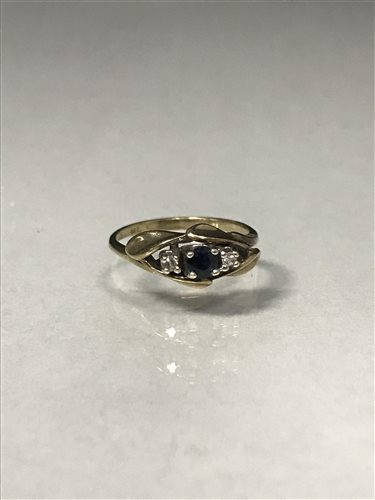 Lot 53-A DIAMOND AND BLUE GEM SET RING