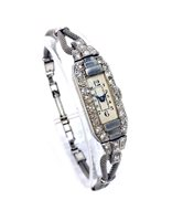 Lot 784-A LADY'S PLATINUM AND DIAMOND COCKTAIL WATCH