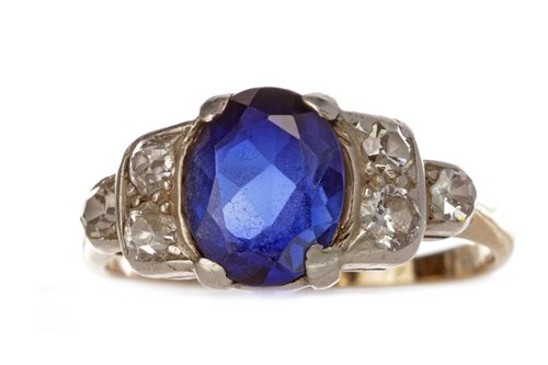 Lot 1-A CREATED SAPPHIRE AND DIAMOND RING