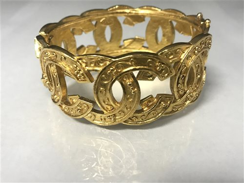 Lot 14-A GOLD PLATED CHANEL BANGLE