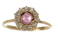 Lot 211 - A RED GEM STONE AND DIAMOND CLUSTER RING