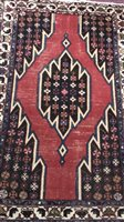 Lot 914-AN EASTERN BORDERED RUG OF KAZAK DESIGN