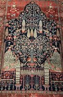 Lot 915-AN EASTERN BORDERED PRAYER RUG OF KIRMAN DESIGN