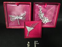 Lot 7-A COLLECTION OF BUTLER AND WILSON BROOCHES