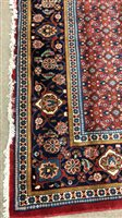 Lot 929-AN EASTERN BORDERED CARPET OF HAMADAN DESIGN