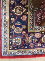 Lot 929-AN EASTERN BORDERED CARPET OF HAMADAN DESIGN