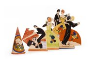 Lot 1286 - A LOT OF THREE 'AGE OF JAZZ' STYLE FIGURE GROUPS WITH A CONICAL CASTER