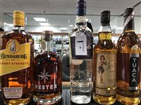 Lot 69-A SELECTION OF RUMS AND A LIQUEUR - FIVE BOTTLES