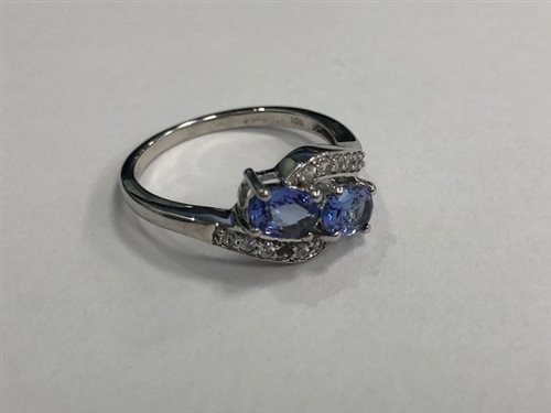 Lot 24-A GEM SET RING