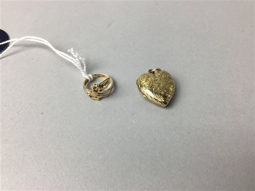 Lot 19-A GOLD RING AND A LOCKET