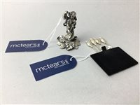 Lot 23-A SILVER CHERUB FIGURE AND A SET OF COCKTAIL STICKS