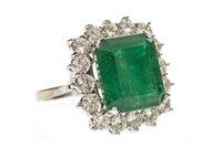 Lot 49-AN IMPRESSIVE GREEN GEM SET AND DIAMOND RING