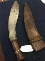Lot 1731-AN EARLY 20TH CENTURY MILITARY ISSUE KUKRI AND TWO OTHER BLADES