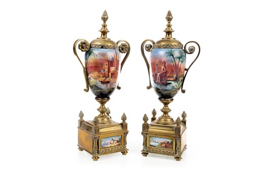 Lot 1822-A PAIR OF BRASS AND CERAMIC GARNITURE VASES