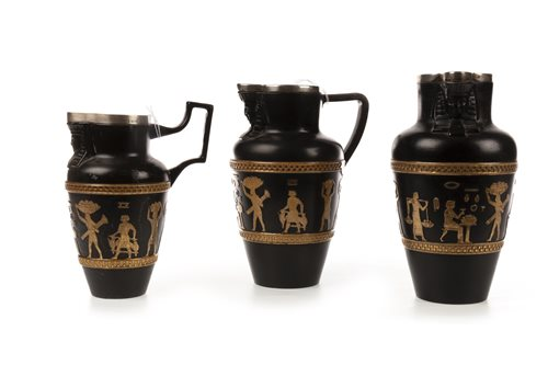 Lot 1861-A PAIR OF DOULTON 'EGYPTIAN REVIVAL' JUGS AND ANOTHER