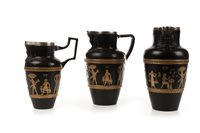 Lot 1861 - A PAIR OF DOULTON 'EGYPTIAN REVIVAL' JUGS AND ANOTHER