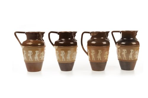 Lot 1866-A LOT OF FOUR DOULTON 'EGYPTIAN REVIVAL' JUGS