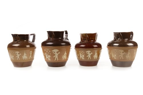 Lot 1872-A LOT OF FOUR DOULTON 'EGYPTIAN REVIVAL' CIDER JUGS