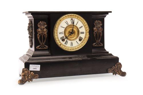Lot 1492 - AN ART NOUVEAU BLACK SLATE MANTEL CLOCK