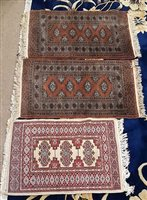 Lot 944-A LOT OF THREE PAKISTANI RUGS