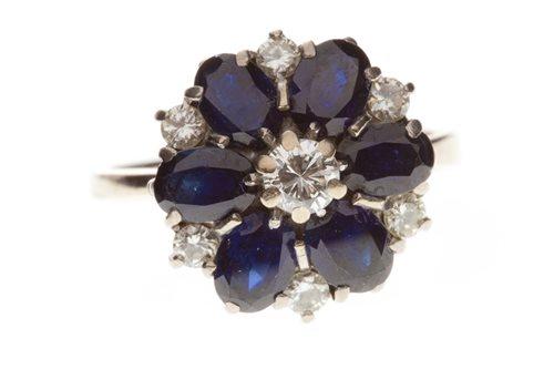 Lot 11-AN IMPRESSIVE BLUE GEM AND DIAMOND DRESS RING