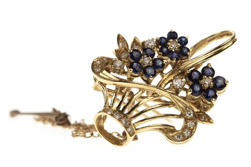 Lot 31-A DIAMOND AND BLUE GEM SET BASKET BROOCH