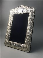Lot 26-AMENDMENT- A VICTORIAN STYLE SILVER PHOTO FRAME