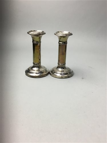 Lot 20-A PAIR OF SILVER CANDLESTICKS AND SILVER CUTLERY