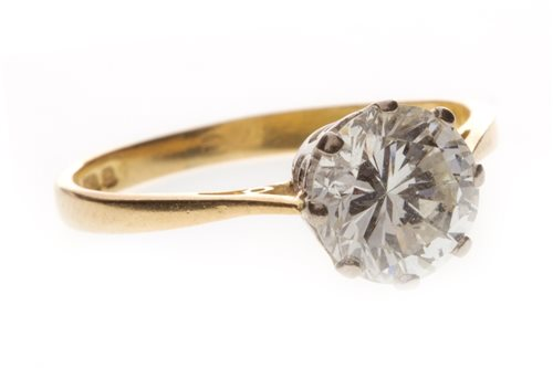 Lot 26-AN EIGHTEEN CARAT GOLD DIAMOND SOLITAIRE RING