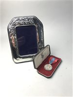 Lot 16-AN IMPERIAL SERVICE MEDAL AND A SILVER PHOTOGRAPH FRAME