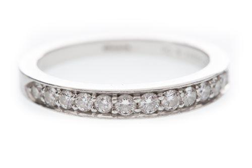 Lot 180 - A DIAMOND SET TIFFANY WEDDING BAND