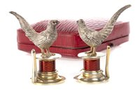 Lot 818-AN UNUSUAL PAIR OF EDWARDIAN SILVER AND ENAMEL MENU HOLDERS