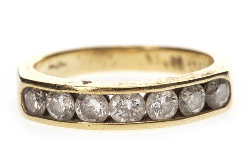 Lot 21-A DIAMOND SEVEN STONE RING
