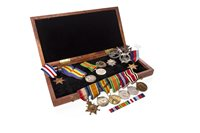 Lot 951-A GROUP OF WAR MEDALS AND BADGES