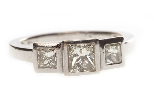 Lot 8-A PRINCESS CUT DIAMOND THREE STONE RING
