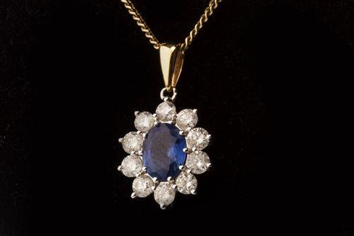 Lot 9-A BLUE GEM AND DIAMOND CLUSTER PENDANT