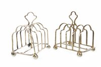 Lot 841 - A SMALL PAIR OF SILVER TOAST RACKS