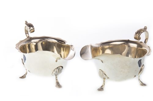 Lot 842 - A PAIR OF EDWARDIAN SILVER SAUCE BOATS