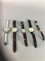 Lot 21-A COLLECTION OF NINE QUARTZ WRIST WATCHES ALONG WITH A NOVELTY DESK CLOCK