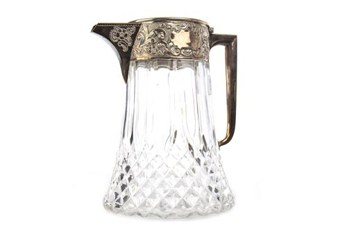 Lot 850 - A SILVER PLATED AND CUT GLASS CLARET JUG