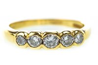 Lot 49 - A DIAMOND SIX STONE RING
