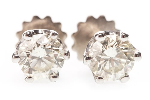 Lot 1-A PAIR OF DIAMOND STUD EARRINGS