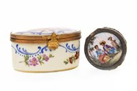 Lot 855 - A CONTINENTAL SILVER GILT AND ENAMEL PILL BOX AND A FRENCH PORCELAIN PILL BOX