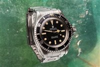 Lot 795 - A GENTLEMAN'S STAINLESS STEEL AUTOMATIC ROLEX SUBMARINER WATCH